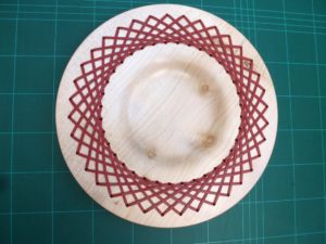 A Sycamore platter with a burgundy red lace